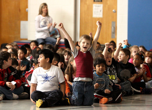Parkwood Elementary School kicked off the Greater Clark County Schools' Mileage Club program Friday with an assembly. All elementary schools participate in the eight-week program that measures steps taken with pedometers. First-grader Jarek Beatty, above, cheered when learning the grand prize for the winning school is a trip to the Jeffersonville Aquatic Center. Staff photo by C.E. Branham