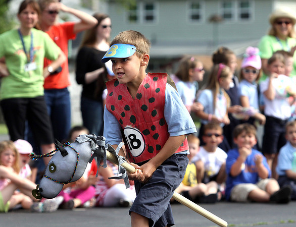 Nolan Finnegan, riding Mr. Sir the Knight III, eyes the finish line en route to winning the annual KinderDerby at St. Anthony Catholic School in Clarksville. Staff photo by C.E. Branham
