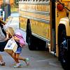 Clarksville Elementary School third-grader Willow Martin leads her sister Rowan Martin, a kindergarten student, off the bus as Clarksville Community Schools students returned to class Monday. Staff photo by C.E. Branham