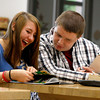 April Powerll and Peyton Pierce, eighth-graders at Highland Hills Middle School flip through a yearbook on Wednesday. The school was one of four in New Albany-Floyd County Consolidated Schools to recieve a Four Star School designation from the state for the last school year. Staff photo by Jerod Clapp