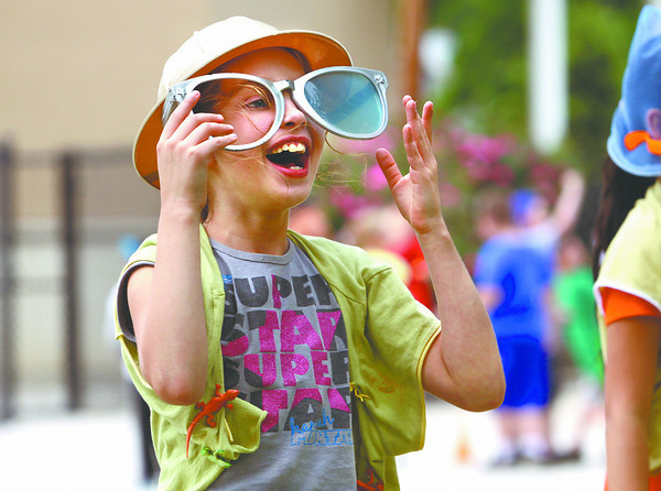 Clarksville Elementary School third-grader Payton Fancher has a laugh in the explorer relay during field day activities Friday afternoon. Staff photo by C.E. Branham