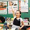 Fourth-grader Sydney Bensing, 9, raises her hand to talk about hooking a reader with a good introduction during a writing  lesson on myths and fantasies in her class at Grant Line Elementary School on Thursday afternoon. Staff photo by Christopher Fryer