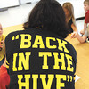 Henryville teachers and staff wore shirts donated by a local vendor for their first day back in the rebuilt school. Staff photo by C.E. Branham