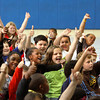 Maple Elementary School students give thumbs up or down to skits performed by faculty and staff during a ISTEP+ pep rally Friday. The skits emphasized getting enough sleep, wearing comfortable clothes, being on time and eating a good breakfast. Testing begins on Monday. Staff photo by C.E. Branham