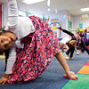 Kindergarten student Catherine Arellano, 6, pulls off a yoga pose while visiting Missy Julian's classroom, where the theme was India, during International Day at Fairmont Elementary School on Friday in New Albany. Students traveled around to classrooms, all themed after different countries, where they listened to lectures and participated in hands-on activities designed to expose them to foreign cultures. Staff photo by Christopher Fryer