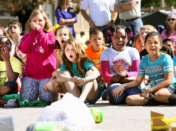 Jonathan Jennings Elementary School third-graders react as their egg containers are dropped from a boom truck Wednesday morning. Nearly 100 students put their engineering skills to test by building a protective crate for a egg that was dropped from various heights. The annual event is part of a science project. Staff photo by C.E. Branham