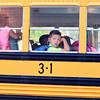A student looks through the bus window at the open doors leading into Grant Line Elementary on the first day of school Thursday morning in New Albany. <br /> Staff photo by Tyler Stewart