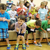 Students of Ms. Kitzmiller's first grade class sing and dance in the gymnasium at Grant Line Elementary before heading to their classroom to begin the school year Thursday morning in New Albany.<br /> Staff photo by Tyler Stewart