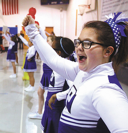Alexis Lamarr and the Parkwood Elementary School cheerleading squad led the student body in a cheer to start the wellness initiative challenge.  Staff photo by C.E. Branham