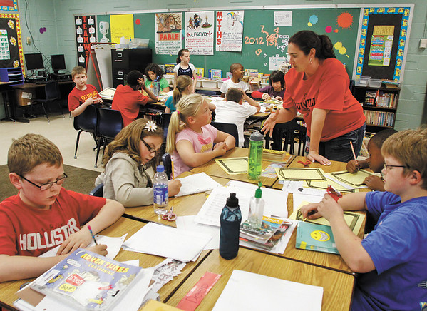 Fourth-grade teacher Julie Beatty works on a myths and fantasies writing lesson with her class at Grant Line Elementary School on Thursday afternoon. Staff photo by Christopher Fryer