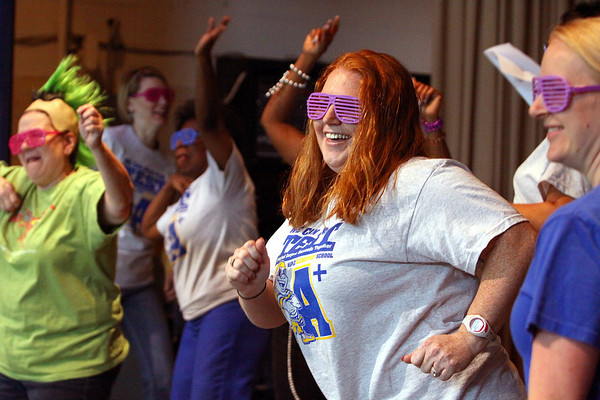 Maple Elementary teacher Mrs. Meredith Terry and other faculty members perform a dance at the end of a ISTEP+ pep rally Friday. Staff photo by C.E. Branham