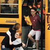 Henryville Elementary School PTO Vice President Traci D'Angelo greets second grader Claire Tucker as she and other students arrive at the former Graceland Christian School at Graceland Baptist Church in New Albany on Wednesday morning for their first day of school since the March 2 tornadoes. Henryville Elementary will be holding classes at the facility until at least the end of the school year. Staff photo by Christopher Fryer
