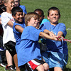 Parkwood Elementary School fifth-graders Dawson Pierce, left, and Joseph Stamper get into a heated tug of war contest during field day festivities Wednesday. Staff photo by C.E. Branham