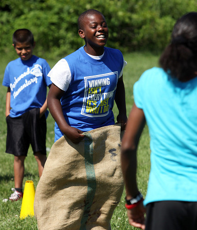 Parkwood Elementary School fifth-grader Devyn Rivers enjoys a sack race during field day Wednesday. Staff photo by C.E. Branham