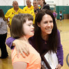 Georgetown Elementary School teacher Sarah Zeinemann poses with student Olivia Lundy after a ceremony Monday morning where Zeinemann was named the Special Needs Teacher of the Year by D.A.D.S. of Kentuckiana. Staff photo by C.E. Branham