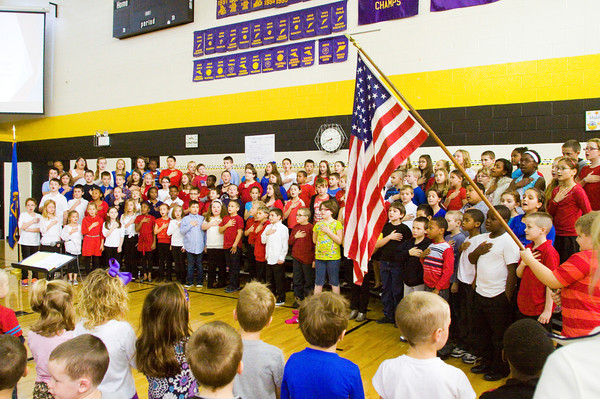 Grant Line Elementary School fourth-graders lead their fellow students during the singing of the national anthem at the school's Veterans Day Program on Friday morning. Staff photo by Christopher Fryer