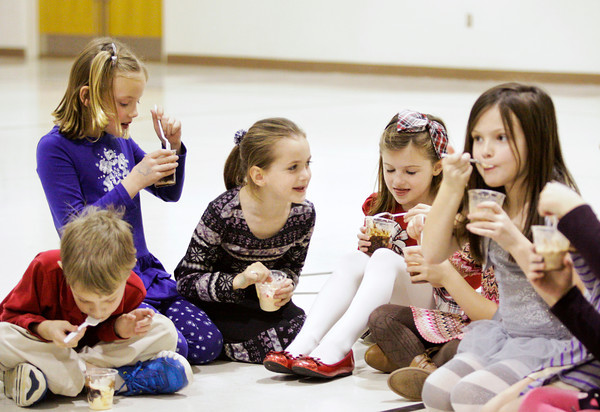 St. Paul Catholic School second-graders dig in to their ice cream during Sundaes for Sundays in their gymnasium on Wednesday afternoon in Sellersburg. The frozen treats were served up as part of the school's celebration of Catholic Schools Week. Staff photo by Christopher Fryer