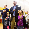 Navy veteran Joe Dablow, New Albany, left, stands with his daughter Ellie, 7, and Air Force veteran Doug Tate, Corydon, stands with his daughter Gaby, 6, during the Pledge of Allegiance at the Grant Line Elementary School Veterans Day Program on Friday morning. Staff photo by Christopher Fryer