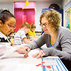 Fairmont Elementary School first-grade teacher Stephanie Watson helps Elena Godinez during their daily math review on Friday morning in New Albany. Fairmont was named a 2013 National Blue Ribbon School by the U.S. Department of Education earlier this week. Staff photo by Christopher Fryer