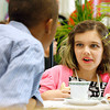 Shelby Fultz, a third-grader at Mount Tabor Elementary School, socializes with her classmates during the school's seventh annual tea party. On top of the manners they're taught before the event, the school holds the party as an end of the year celebration. Staff photo by Jerod Clapp