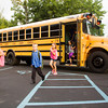 S. Ellen Jones Elementary School students exit their bus as they arrive for the first day of classes in New Albany on Thursday morning. Staff photo by Christopher Fryer