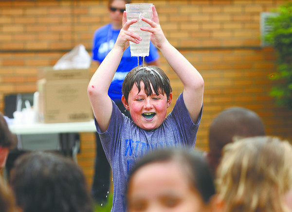 Second-grader Kane Shelton gets a little wet in a water relay during field day at Clarksville Elementary School on Friday. Staff photo by C.E. Branham