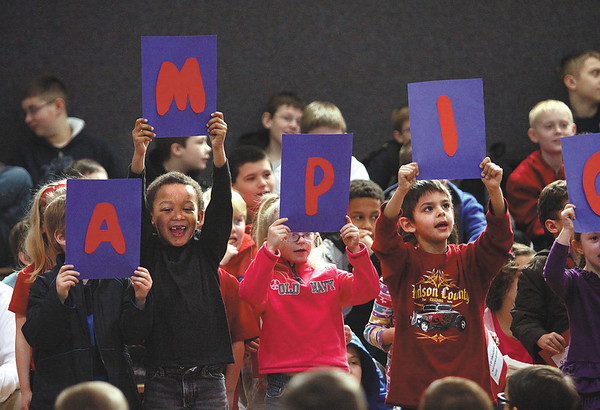 """Utica Elementary School kindergarten students spell out """"Champions"""" as they present a Black History Month presentation Thursday morning on Muhammad Ali.  Staff photo by C.E. Branham"""