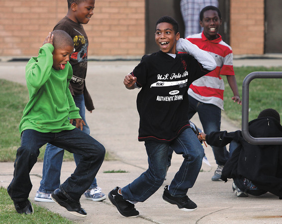 Brenton Taylor, left, and Zachariah Chambers work on their dance steps Wednesday evening at the annual Spring Hill Elementary School picnic. Staff photo by C.E. Branham