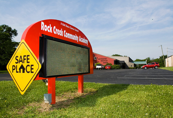 The sign for Rock Creek Community Academy is pictured at the front of the campus along U.S. 31 near Sellersburg on Tuesday morning. Staff photo by Christopher Fryer