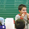 In celebration of Valentine's Day, students at Maple Elementary were treated to blood oranges, mangos, star fruit and fresh vegetables as part of the United States Department of Agriculture and Indiana Department of Education Fresh Fruit and Vegetable Program.  Bridgepoint, Parkwood, and Spring Hill are also part of the program that provides free fresh fruit and vegetables during the school day.  Maple second-grader Karter Capps, above, enjoys a blood orange wedge Tuesday afternoon.  Staff photo by C.E. Branham