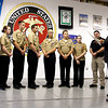 The New Albany High School Navy JROTC Rifle Team recieves a copy of a resolution from Rep. Ed Clere congratulating them on their national title for 2013. The resolution was sponsored by Sen. Ron Grooms, R-Jeffersonville. The team competed in the 2013 Navy National Rifle Championship in March, taking the top spot over 600 other teams from across the country. Master Gunnery Sgt. Lyn Akermon, Caleigh McLean, Brandon Longacre, Sam Harris, Caleb Hardin, Luke Rhoades, Kathryn Davis and coach Steve Harris are pictured with Clere. Staff photo by Jerod Clapp