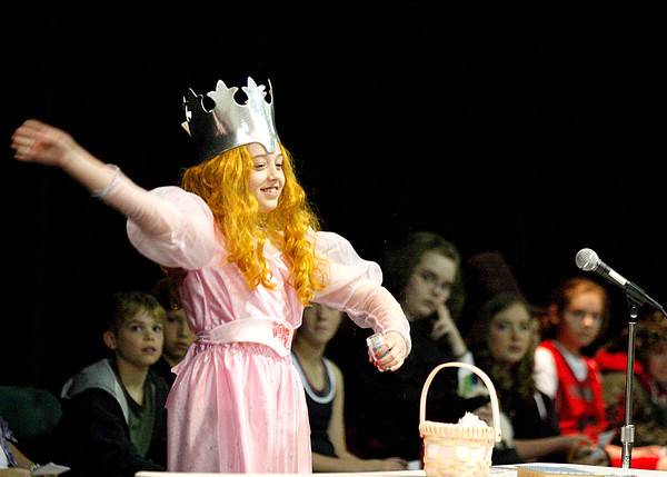 """Anna Clarke, a fifth-grader at Highland Hills Middle School, starts her speech off with a touch of magic as Glinda the Good Witch from """"The Wizard of Oz"""" during the school's fifth-grade speech contest on Wednesday. Highland Hills was one of the five schools in New Albany-Floyd County Consolidated Schools recognized as a Four-Star School. Staff photo by Jerod Clapp"""
