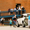 St. Mary's Catholic Academy students leave the building on the last day of school following an end of school assembly on Friday afternoon in New Albany. Ongoing debt forced the school to close its doors at the end of the 2012-2013 school year. Staff photo by Christopher Fryer