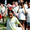 Parkwood Elementary School third-grader Tania Boswell competes in a cup and water relay during field day festivities Wednesday at the Clarksville school. Staff photo by C.E. Branham