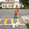 New Albany Street Department painter Steve Swearingen, New Albany, repaints crosswalk lines at the corner of Culbertson Avenue and East 11th Street next to S. Ellen Jones Elementary School in New Albany on Thursday morning. Staff photo by Christopher Fryer