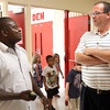 Leonard Gbloh, Education Secretary of United Methodist Church schools in Sierra Leone, talks with Mt. Tabor Elementary School assistant principal Scott Hughes Monday morning. Gbloh was touring Mt. Tabor and Christian Academy of Indiana. Staff photo by C.E. Branham