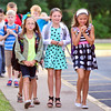 Students make their way to the entrance after getting off the bus for their first day of school at Grant Line Elementary in New Albany Thursday morning. <br /> Staff photo by Tyler Stewart
