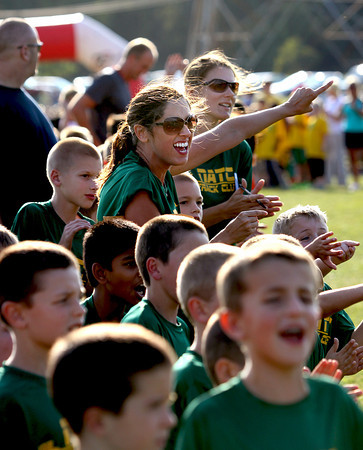 Georgetown Elementary School students and coaches cheer on their girls at the finish line of the elementary school cross country meet Thursday at Community Park. Staff photo by C.E. Branham