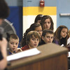 Thomas Jefferson Elementary School D.A.R.E program essay winners watch as a classmate reads his essay during graduation ceremonies Friday morning.  Staff photo by C.E. Branham