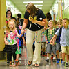 Jennie Hamilton walks with her kindergarten class from the gym as they make their way to the classroom for the first day of school at Grant Line Elementary in New Albany Thursday morning. <br /> Staff photo by Tyler Stewart
