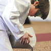 Highland Hills sixth-grader fills cups of sand which were used as weight in the tower competition at the 2012 Science Olympiad Saturday at IUS.  Staff photo by C.E. Branham