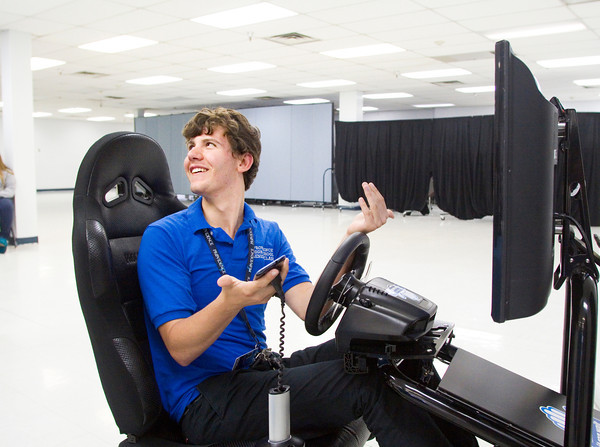 Senior Kynan Jarrett reacts after virtually crashing while operating a texting and driving simulator during an AT&T Texting & Driving...It Can Wait campaign stop at Our Lady of Providence Junior/Senior High School in Clarksville on Wednesday afternoon. Staff photo by Christopher Fryer