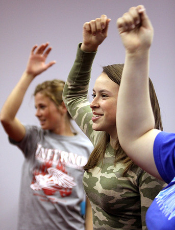 Henryville student Holly Butts and classmates dance to a Wii game in their physical education class. Staff photo by C.E. Branham