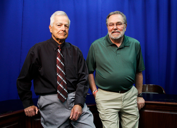 Bob Dusch, left, and Lee Kelly stand in the television studio at New Albany High School on Friday morning. Kelly has been teaching for 40 years, and Dusch for 47 years, they are both retiring next week. Staff photo by Christopher Fryer