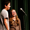 "Landon Tak, left, and Sophie Howie share a laugh after competing for first place in the seventh-grade Highland Hills Middle School Spelling Bee on Wednesday afternoon. One of 15 contestants, Howie won the contest in the 22 round after Tak misspelled the word ""villain"" and she correctly spelled it and successfully spelled ""heredity"" to seal her victory. She will move on to the Floyd County Spelling Bee in February along with fifth-grader Adam Hynes, sixth-grader Taylor Coats and eighth-grader Karli Coleman. Staff photo by Christopher Fryer"