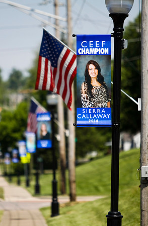 Student banners hang from light poles along Market Street in Charlestown on Monday morning. Currently, more than 90 percent of Charlestown High School's seniors have been recognized with the banners by the Charlestown Excellence in Education Foundation. They are designed to recognize academics on the same level as athletics, and only students who have been accepted to a college, vocational school or the military qualify for the program. Staff photo by Christopher Fryer