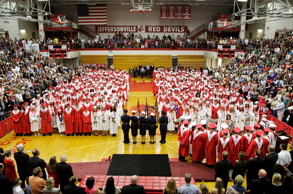 "Seniors in the class of 2012 listen as the senior choir sings the ""Star Spangled Banner"" during their commencement ceremony in the gymnasium at Jeffersonville High School on Friday night. Staff photo by Christopher Fryer"