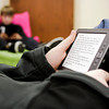 Highland Hills Middle School seventh-grader Michael Atwood uses an Amazon Kindle e-reader during his remedial reading class on Tuesday morning. The class, taught by Carla Thomas, currently has seven of the devices and will soon be acquiring three Kindle Fires to help students with mobility issues. Staff photo by Christopher Fryer