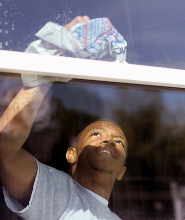 Rock Creek student Joseph Logsdon took on window cleaning at the Clark County Youth Shelter. Staff photo by C.E. Branham