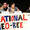 Makayla Spaulding, center, contemplates her answer while contestants Bailey Caruthers and A.J. Rousseau listen during the 10th annual National Geographic Bee Tuesday morning at River Valley Middle School. Staff photo by C.E. Branham
